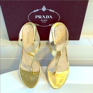Gold Prada wedge shoes